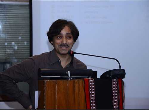 The famous cartoonist Mr Sharad Sharma giving presentation at the conference